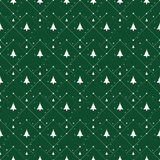 Christmas pattern with small stars, snow and Christmas trees. On green background Stock Photography