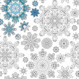 Christmas pattern from snowflakes for a card vector.   coloring book.  hand-drawn doodle decorative elements in . Black Stock Images