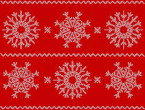 Christmas pattern with snowflakes, new year ornament on red back. Ground. Knitted vector pattern. Christmas sweater design. Wool knitted texture in white and red vector illustration
