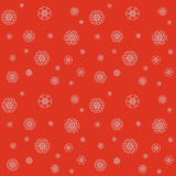 Christmas pattern with snowflakes on a red background. Christmas vector illustration with snowflakes in red and white color. Seamless bright festive pattern is Royalty Free Stock Images