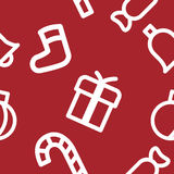 Christmas pattern. Christmas symbols on a red background. It can be used as a seamless texture Royalty Free Stock Images
