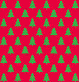 Christmas pattern with trees. On red background Royalty Free Stock Image