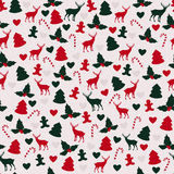 Christmas pattern. Vector seamless pattern for Christmas in green and red colors Stock Photos