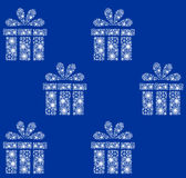 Christmas pattern. White presents on blue. Background Royalty Free Stock Images