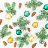 Christmas pattern of winter trees, pine cones and Christmas balls on white background. New year composition. Flat lay, top view. Christmas pattern of winter Stock Photography