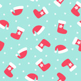 Christmas pattern with xmas socks, stars and Santa hats. Happy New Year and Merry Xmas seamless background. Vector design for winter holidays. Winter holidays Royalty Free Stock Image
