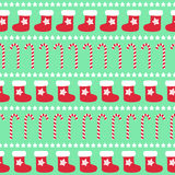 Christmas pattern with xmas stocking, stars and candy canes. Happy New Year and Merry Xmas background. Seamless vector design for winter holidays on mint Royalty Free Stock Image