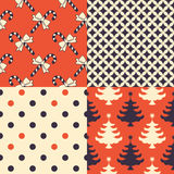Christmas Patterns. Set of 4 seamless Xmas patterns Royalty Free Stock Photo