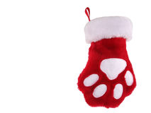 Christmas paw stocking. Red and white christmas stocking with paw print isolated on white background Stock Images