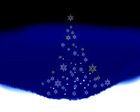 Christmas peace. Snowflake  tree made of falling snowflakes with space for writing below Stock Photo