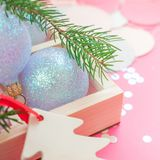 Christmas pearl decoration balls pink background. New Year Christmas Xmas holiday celebration composition pearl decorative toy ball wooden box fir branch royalty free stock images