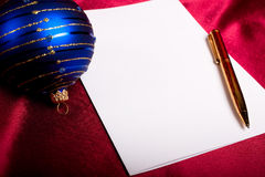 Christmas. Pen, paper and blue ball. Stock Image