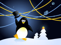 Christmas penguin. Cheerful cartoon penguin holding his hat against decorated Christmas background Stock Image
