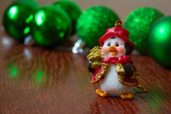 Christmas penguin on the background of Christmas balls. new Year Stock Photo