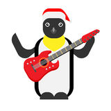 Christmas penguin holds an electric guitar Royalty Free Stock Image