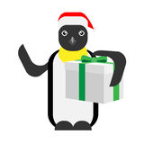 Christmas penguin holds a gift box Stock Photos