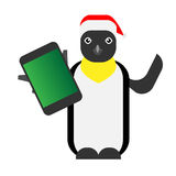 Christmas penguin holds a mobile phone Stock Images
