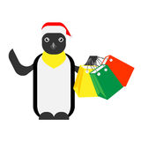 Christmas penguin holds shopping bags Royalty Free Stock Photos