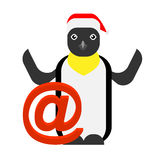 Christmas penguin next to a sign email Stock Photography