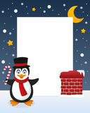 Christmas Night Penguin Vertical Frame. Christmas vertical photo frame with a cute cartoon penguin character, holding a candy cane, on a snowy roof near a Royalty Free Stock Images