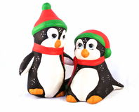 Christmas Penguins. Two hand-painted Christmas penguins royalty free stock photos