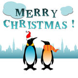 Christmas with penguins. Abstract colorful background with two penguins and the text Merry Christmas written with blue letters. Christmas concept Stock Images