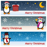 Christmas Penguins Horizontal Banners. A collection of three horizontal banners wishing a merry Christmas, with cute penguin characters on the snow. Eps file Royalty Free Stock Image