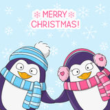 Christmas penguins on snow background Royalty Free Stock Photos