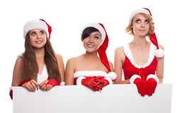 Christmas people, advertisement and sale concept three happy wom Royalty Free Stock Image