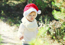 Christmas and people concept - baby in santa red hat Royalty Free Stock Photos