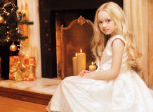 Christmas and people concept - beautiful little girl in dress Stock Photo