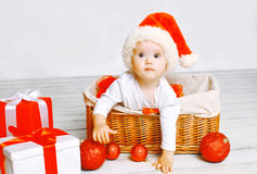 Christmas and people concept - charming baby with gifts. On a white background royalty free stock images