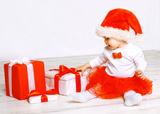 Christmas and people concept - cute baby with gifts Royalty Free Stock Photo