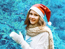 Christmas and people concept - happy girl in red hat Stock Photography