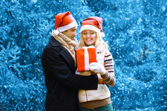 Christmas and people concept - happy man giving a box gift Royalty Free Stock Images