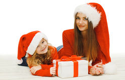 Christmas and people concept - happy mother and child with box Stock Photos