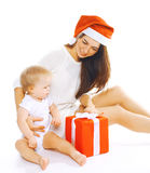 Christmas and people concept - happy mother and child Royalty Free Stock Photos
