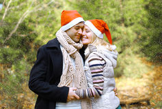 Christmas and people concept - happy pretty couple in love Stock Images