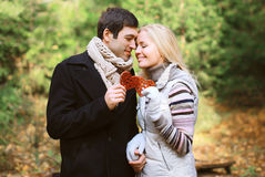 Christmas and people concept - happy pretty young couple in love Royalty Free Stock Photo