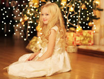Christmas and people concept - happy smiling little girl Royalty Free Stock Photo