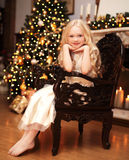 Christmas and people concept - happy smiling little girl Stock Photography