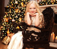 Christmas and people concept - happy smiling little girl Stock Images