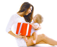 Christmas and people concept - happy smiling mother and child. With box gifts on a white background Royalty Free Stock Images