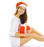 Christmas and people concept - happy smiling woman in santa hat Royalty Free Stock Photo