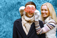 Christmas and people concept - happy young couple in love Stock Images