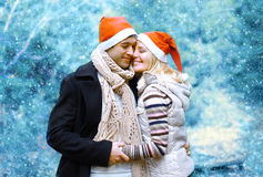 Christmas and people concept - happy young couple in love Stock Image