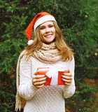 Christmas and people concept - happy young girl in winter hat Stock Photography