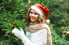 Christmas and people concept - happy young girl in winter hat Royalty Free Stock Images