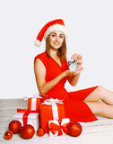 Christmas and people concept - smiling woman and alarm clock Stock Photography