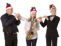 Christmas people play music Royalty Free Stock Images